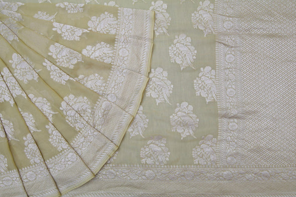 Butter Yellow Banarasi Georgette Saree With Elaborate Peacock Motifs.