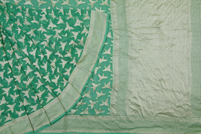 Seafoam Green Banarasi Georgette Saree With Flying Crane Motifs.
