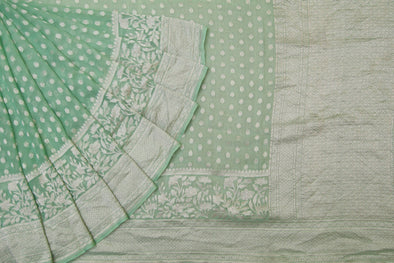 Mint Green Banarasi Georgette Saree With Delicate Floral Buttas.