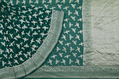 Pine Green Banarasi Georgette Saree With Fluttering Bird Motifs.
