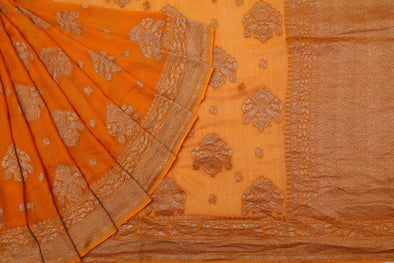 Apricot Yellow Banarasi Georgette Saree With Elaborate Traditional Buttas.