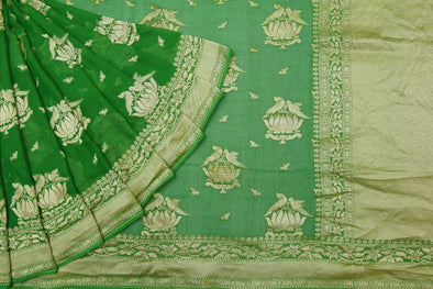 Basil Green Banarasi Georgette Saree With Parrot and Lotus Motifs.
