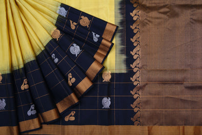 Light Yellow Gadwal Handloom Silk Saree with Checks Border.