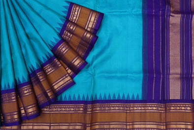 Peacock Blue Gadwal Silk Handloom Saree with Blue Violet Kuttu Border