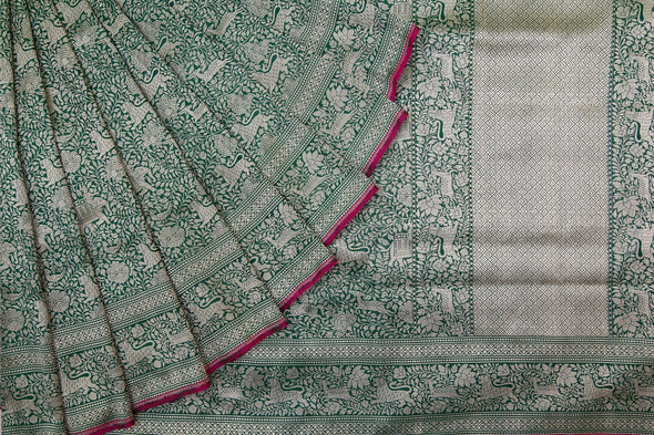 Emerald Green Banarasi Brocade Handloom Saree With Animals And Leafy vines motifs
