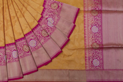 Tuscan Yellow Banarasi Silk Saree With A Contrast Rani Pink Border