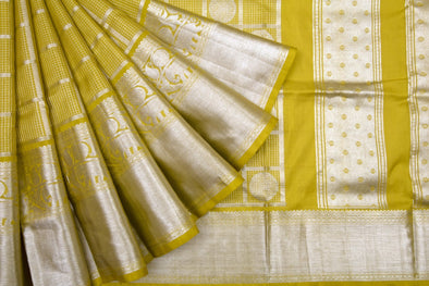 Medallion Yellow Venkatagiri Silk Handloom Saree With Checks And Chakra Motifs