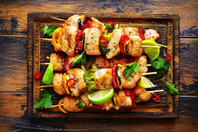 Our grilled chicken breasts bites are marinated in soy sauce, lime juice and honey and basted with a mild Sriracha sauce. Served over spinach with red peppers, zucchini and squash. Low carb, healthy, Paleo, keto, diet, friendly.