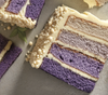 Blueberry Ombre Cake. You will love this decadent blueberry ombre cake, four layers of delicious moist cake are framed with sweet vanilla icing, one slice per order.