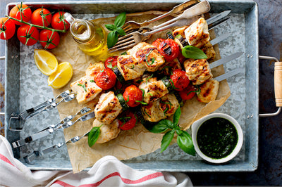 Grilled Chicken Skinny Bites - Low Carb. This recipe will be your favorite skinny low carb dish. Our grilled chicken breasts are marinated in olive oil, lime juice and honey and basted with a mild Sriracha sauce. Served over spinach with red peppers, zucchini and squash.