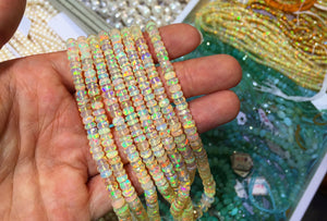 Strands of opal beads at gem show