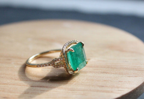 Side view of completed emerald and diamond gold ring for Sea and Stone Jewelry