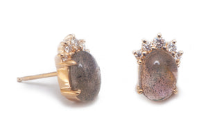 Sea and Stone Jewelry -  Stud earrings featuring labradorite cabochons set in 14 karat yellow gold with a curve of four diamonds underneath. side view.