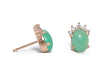Sea and Stone Jewelry -  Stud earrings featuring chrysoprase cabochons set in 14 karat yellow gold with a curve of four diamonds underneath. Side view.