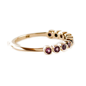 Sea and Stone Jewelry - Bezel ring with 10, 2 millimeter faceted round rhodolite garnet stones set in 14k yellow gold. Side view.