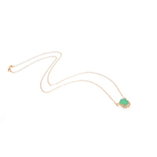 Sea and Stone Jewelry -  A chrysoprase cabochon pendant, set in 14 karat yellow gold with a curve of four diamonds underneath, hangs from a gold chain necklace.