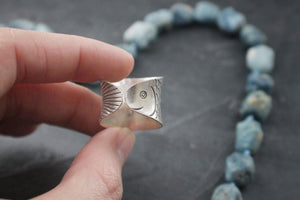 Sea and Stone Jewelry - Hill tribe silver adjustable ring, stamped with detailed fish design. adjustable tail and head side shown. Close up.