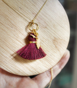 Sea and Stone Jewelry - Garnet tassel pendant and gold Florida State charm hang from a hammered gold circlet on a gold vermeil necklace. Close up.