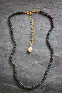 Sea and Stone Jewelry - Black Opal Beaded Necklace Hand Knotted on Silk and Finished in a Gold-Plated Extender Chain with a Pearl Accent Charm