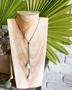 Sea and Stone - Large Adjustable Baroque Pearl Lariat on Blackened Sterling Silver Chain shown on Wooden Necklace Stand