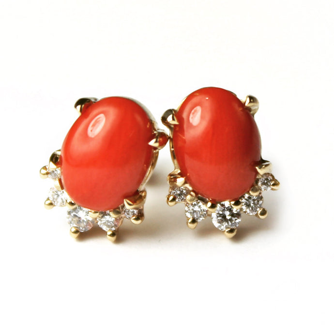 Sea and Stone Jewelry -  Stud earrings featuring coral cabochons set in 14 karat yellow gold with a curve of four diamonds underneath. Close up.