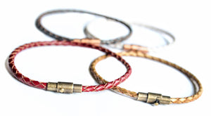 Sea and Stone Jewelry - A thin braided leather bracelet with a magnetic clasp. Shown in 4 colors: Blue, white, red and yellow.
