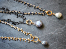 Sea and Stone Jewelry - Dainty gemstone necklaces in gold plated or blackened sterling silver, with a fringe of tiny gemstones down the chain and a large gemstone pendant.