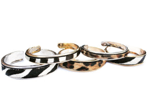 Sea and Stone Jewelry - Animal Print Cuff Bracelets Made from Zebra or Leopard Printed Haircalf Leather, Inlayed into Thick or Thin Gold or Silver Plated hypoallergenic and Lead Free, Nickel Free, and Cadmium Free Metal Cuffs.