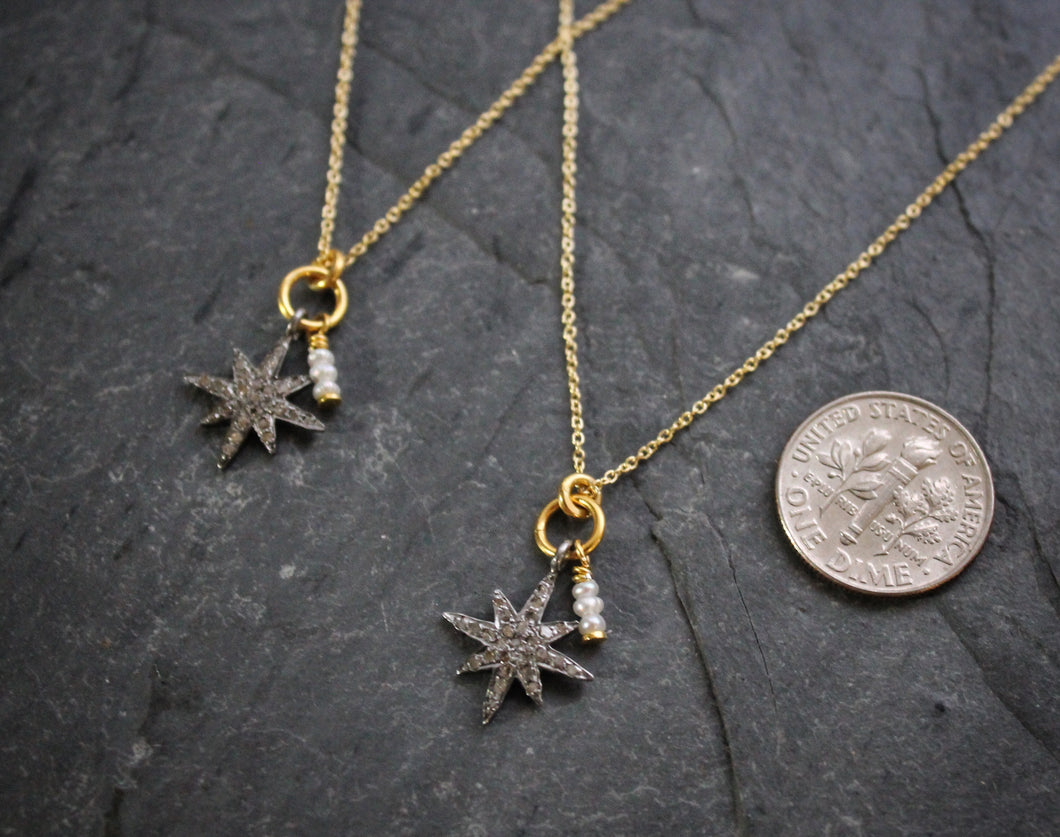 Sea and Stone Jewelry - Dainty sterling silver star pendant studded with pave diamonds and embellished with a pearl charm on a gold vermeil necklace. Dime beside for size reference.