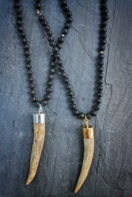 Sea and Stone Jewelry - A whitetail deer antler tip pendant hangs from a lave stone bead necklace with gold or silver vermeil finishings.