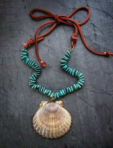 Sea and Stone Jewelry - A gold edged scallop shell pendant hangs from a turquoise bead necklace ending in soft deerskin espresso suede. Finished in gold vermeil components.