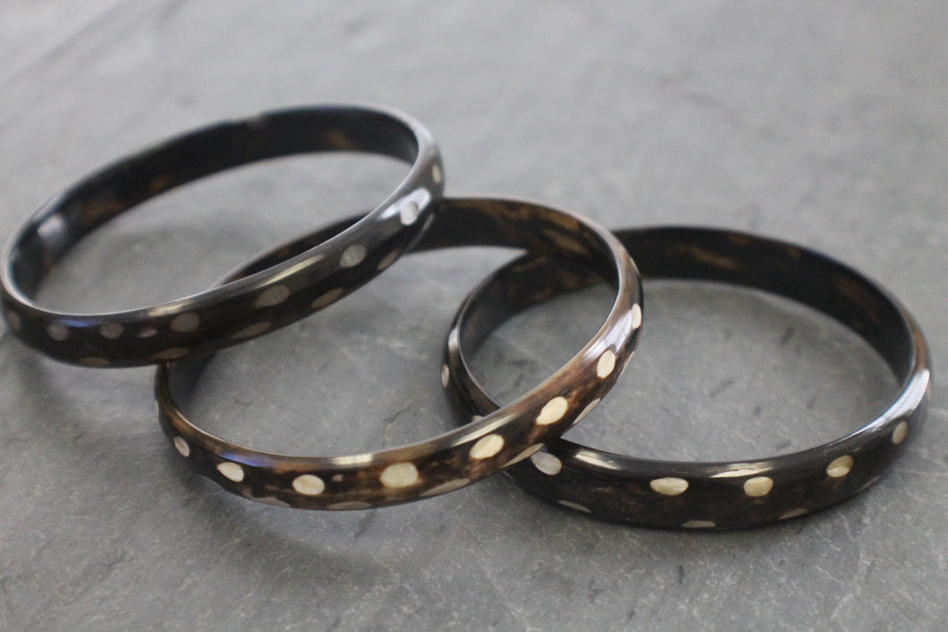 Sea and Stone Jewelry - Bangle bracelets made of natural buffalo horn. Color is dark with light contrast.
