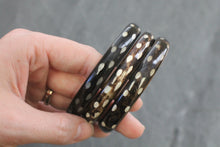 Sea and Stone Jewelry - Bangle bracelets made of natural buffalo horn. Color is dark with light contrast. Variations in color shown.