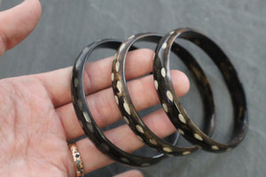 Sea and Stone Jewelry - Bangle bracelets made of natural buffalo horn. Color is dark with light contrast. Shown in a group of three.