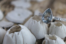 Sea and Stone Jewelry - A pear shaped aquamarine stone set in a white gold ring with diamonds studding the band set on small barnacles