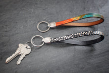 Sea and Stone Jewelry - leather keychains printed with bright patterns. Metal ring and fittings are silver colored.