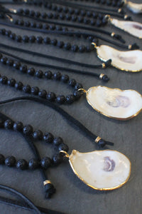 sea and stone jewelry Oyster Shell, Lava, & Suede Necklace