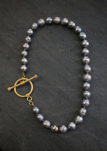 Sea and Stone Jewelry - A necklace of organic shaped peacock pearls finished with a textured yellow gold vermeil toggle clasp.