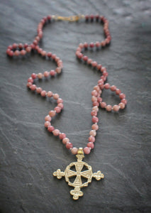 Sea and Stone Jewelry - A brass Ethiopian cross pendant hangs from a rhodonite bead necklace with a gold vermeil clasp.