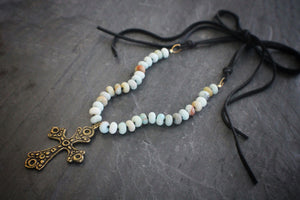 Sea and Stone Jewelry - A brass cross pendant hangs from an amazonite bead necklace  with gold vermeil components, ending in strands of soft deerskin suede. Suede shown in charcoal.