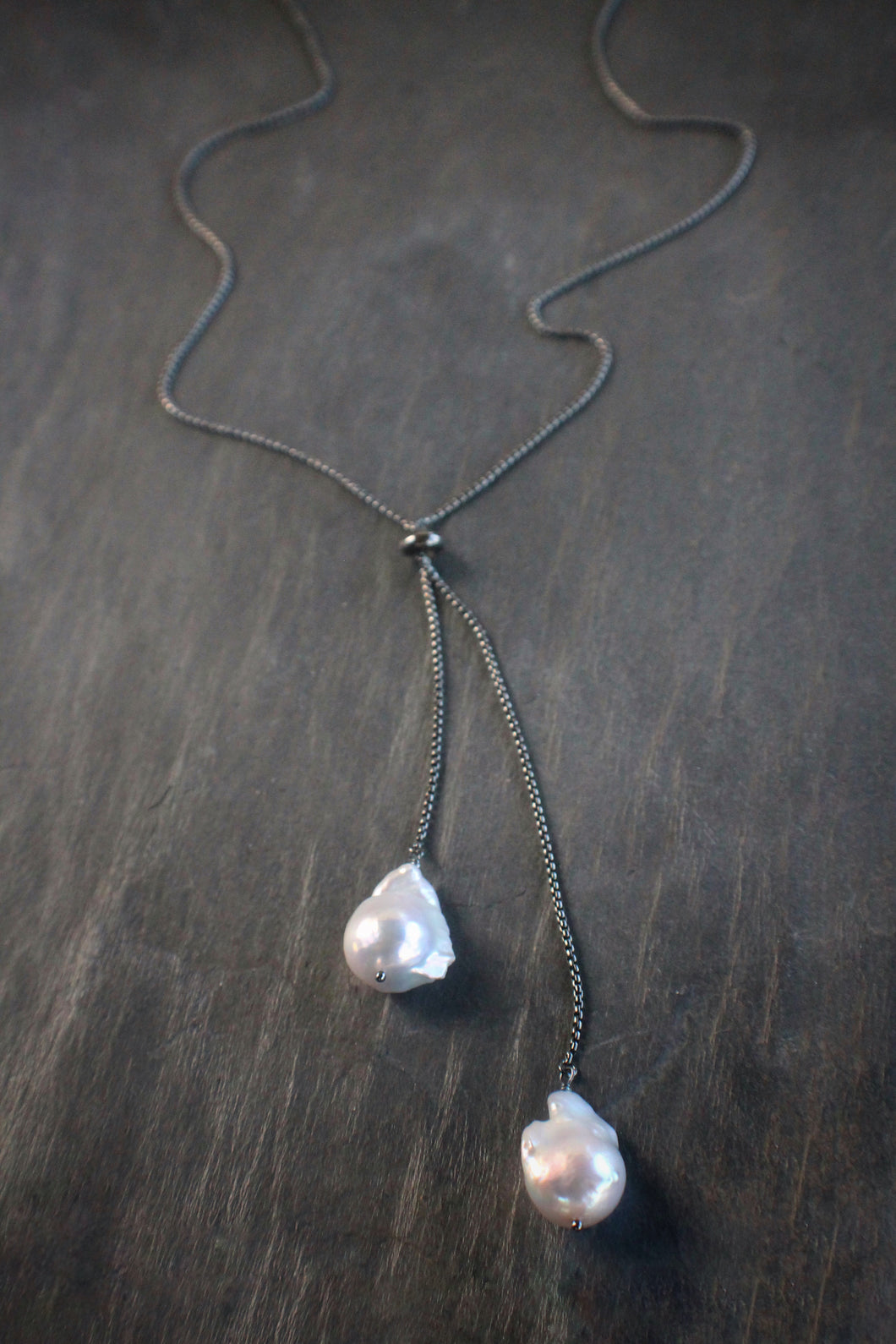 Sea and Stone Jewelry - Adjustable baroque pearl lariat necklace on blackened sterling silver.
