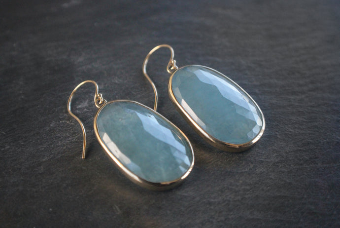 Sea and Stone Jewelry - Drop earrings featuring large, rose cut, aquamarines set in and hanging from 14 karat yellow gold hook ear wires.