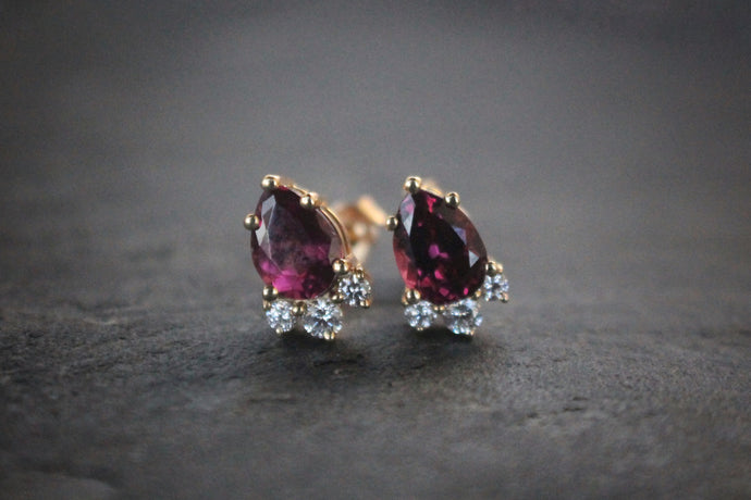 Sea and Stone Jewelry - Stud earrings feature pear shaped rhodolite garnets and natural diamonds set in 14 karat yellow gold.