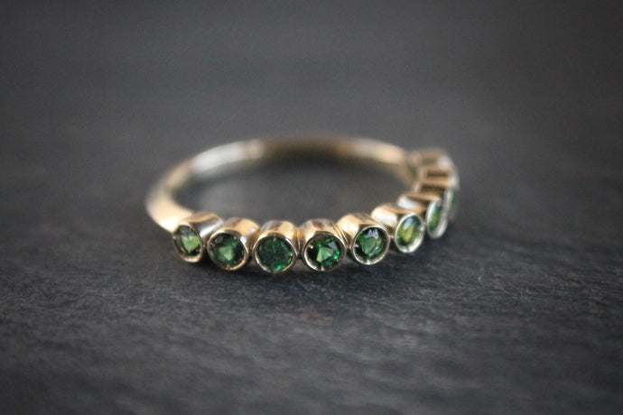 Sea and Stone Jewelry - Bezel ring with 2 millimeter faceted round Tsavorite, beautiful emerald green colored garnet, stones set in 14 karat yellow gold.