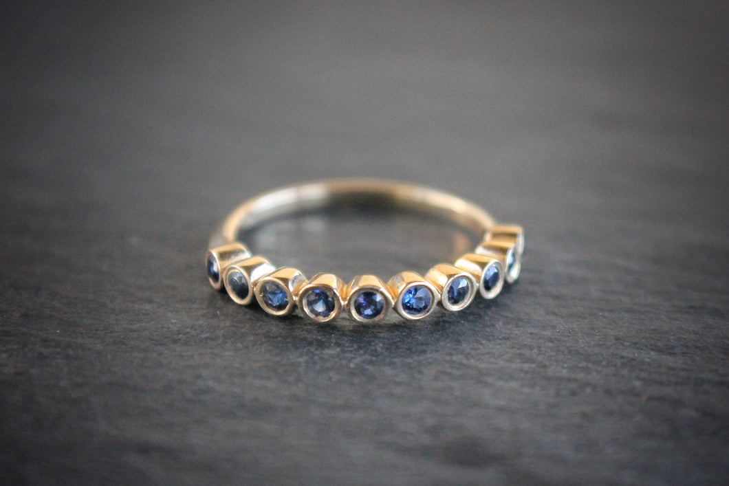 Sea and Stone Jewelry - Bezel ring with 2 millimeter faceted round sapphire stones set in 14 karat yellow gold. September birthstone.