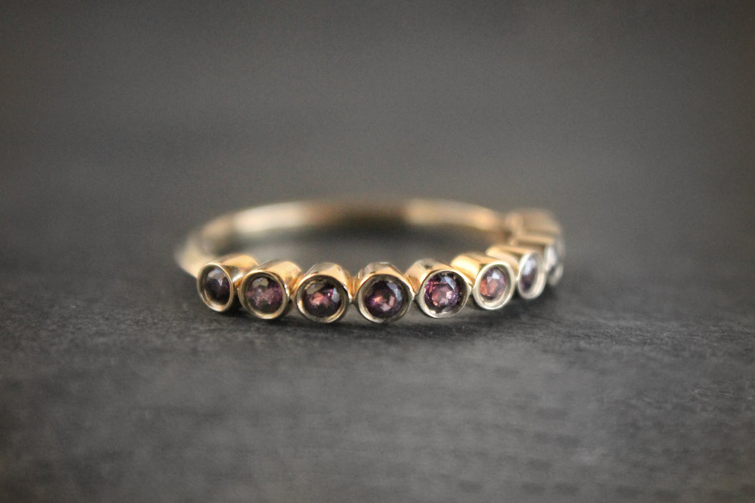 Sea and Stone Jewelry - Bezel ring with 10, 2 millimeter faceted round rhodolite garnet stones set in 14k yellow gold. January birthstone.