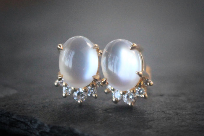 Sea and Stone Jewelry -  Stud earrings featuring white sapphire and mother of pearl doublet cabochons set in 14 karat yellow gold with a curve of four diamonds underneath.