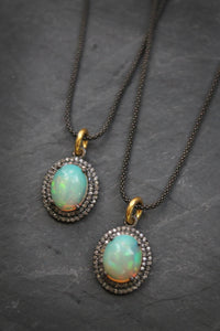 Sea and Stone Jewelry -  A necklace with an opal pendant set into blackened silver surrounded by diamond on a blackened silver chain.