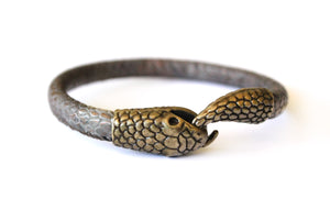 Sea and Stone Jewelry - A cuff bracelet in the shape of an Ouroboros, or a snake biting it's own tail. The body of the snake is grey colored with snake print detailing while the head and tail are bronze with scale detailing.