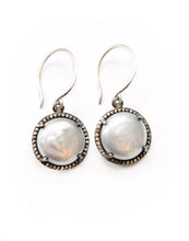 Sea and Stone Jewelry - Drop earrings with pearls set in oxidized silver and embellished with a diamond surround, hung on silver hook ear wires. Silver white pearl shown.